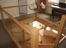 Polished oak Timber and Glass Staircase landing