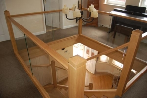 Polished oak Timber and Glass Staircase landing Irvine