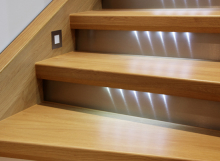 Staircase with wooden steps and lights