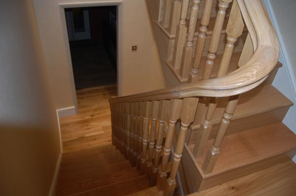 Timber Staircase With Curved Handrails